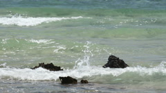 Waves and stones. 60 seconds Stock Footage