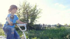 boy rides a bicycle - stock footage
