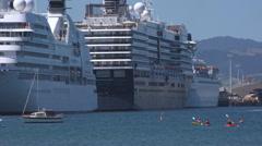 Three cruiseships alongside wharf - stock footage