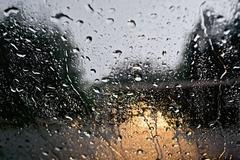 Raindrops with yellow car headlights - stock photo