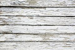 Boards covered with white cracked paint Stock Photos