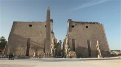 PINK GRANITE OBELISK & FIRST PYLON TEMPLE ENTRANCE, LUXOR, EGYPT Stock Footage