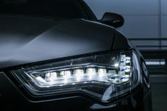 Headlight of prestigious car close up Stock Photos