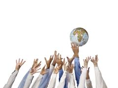 group of hand reaching the globe - stock photo