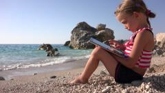 4K Child on Tablet on Sea Beach View Little Girl Playing Ipod Seashore, People Stock Footage