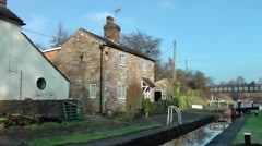 Macclesfield canal Lock keepers cottage on canal rural setting Stock Footage