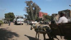 BUSY ROAD CROSSING, NAGAA EL-SHAIKH ABOU AZOUZ, EGYPT Stock Footage
