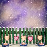 snow-covered wooden fence with hanging on it with paper hearts a - stock illustration