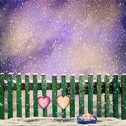 snow-covered wooden fence with two paper hearts - stock illustration