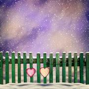 Snow-covered wooden fence with two paper hearts Stock Illustration