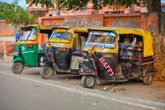 AGRA, INDIA Three, colorfully painted, motorized rickshaws, - stock photo