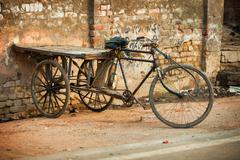 AGRA, INDIA An improvised tricycle with a wooden cargo pall Stock Photos
