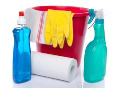 Bucket with cleaning products and cleaning material - stock photo