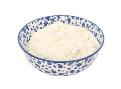 All purpose flour in a blue and white china bowl - stock photo