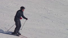 Skier rides on the ski track. Slow motion Stock Footage