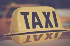 Taxi Cab Car Roof Sign Close Up in Retro Film Style Stock Photos