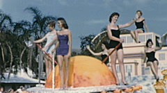 Tampa 1959: young girls in swimming trunks in a floatat Gasparilla parade Stock Footage
