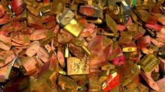 Close up pan across love padlocks under sunset rays in Paris, France Stock Footage