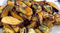 Preserved Mussels (seamless loopable) Stock Footage