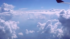View on sky and clouds. Wing of airplane from window. HD. 1920x1080 Arkistovideo