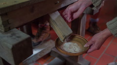 Traditional way to make flour Stock Footage