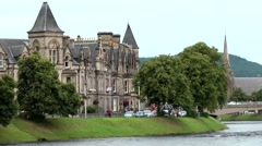 Scotland city of Inverness 036 British houses at green river shore - stock footage