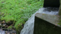 Small waterfall under the bridge Stock Footage