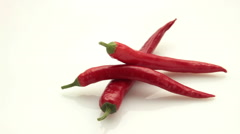 Chili pepper tracking on white Stock Footage