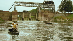 Aerial shot of dam river fisherman's soldier military fly over to zoom in Stock Footage