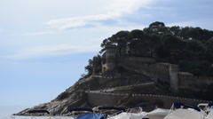 People Walking Uphill to a Castle on a Cliff Stock Footage