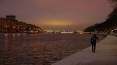 Skier on the waterfront in snowy city, p.2 Stock Footage
