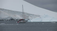 Small yacht in Paradise Harbour, Antarctica Stock Footage