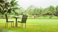 Tropical park with chairs Stock Footage