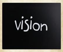 """""""Vision"""" handwritten with white chalk on a blackboard Stock Photos"""