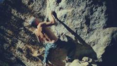Climbing a rock - stock footage