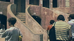 Senegal 1985: tourist visiting former slave departure place Stock Footage