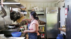 Woman cooking in kitchen Stock Footage