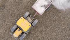 Overhead view of a Tractor fertilizing a field Stock Footage