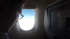 Man traveling by air. View through an airplane window the airplane wing -Dan Stock Footage