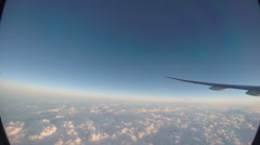 View through an airplane window the airplane wing above the clouds -Dan Stock Footage