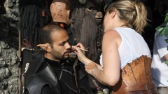 Creating elf ears during Medieval event Stock Footage
