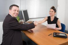 Man meeting financial adviser at her office Kuvituskuvat