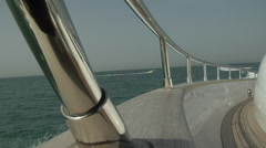 Shot on the deck at the side of a Cruise boat as it sails in the ocean. Stock Footage