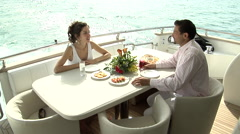 A couple dining on a boat while on a cruise. - stock footage