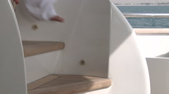 Shot of a man's legs walking down a flight of stairs on a boat. Stock Footage