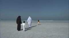 An Arab family walks on the beach. Stock Footage