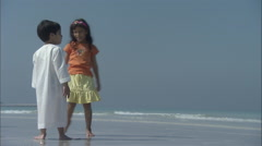Arabic children looking out to sea. - stock footage