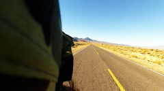Backward View Of Motorcycle On Desert Road Stock Footage