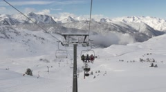 Ski lift with the pyrenees in the background Stock Footage