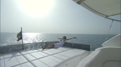 A woman relaxes and enjoys her time on a cruise boat. Stock Footage